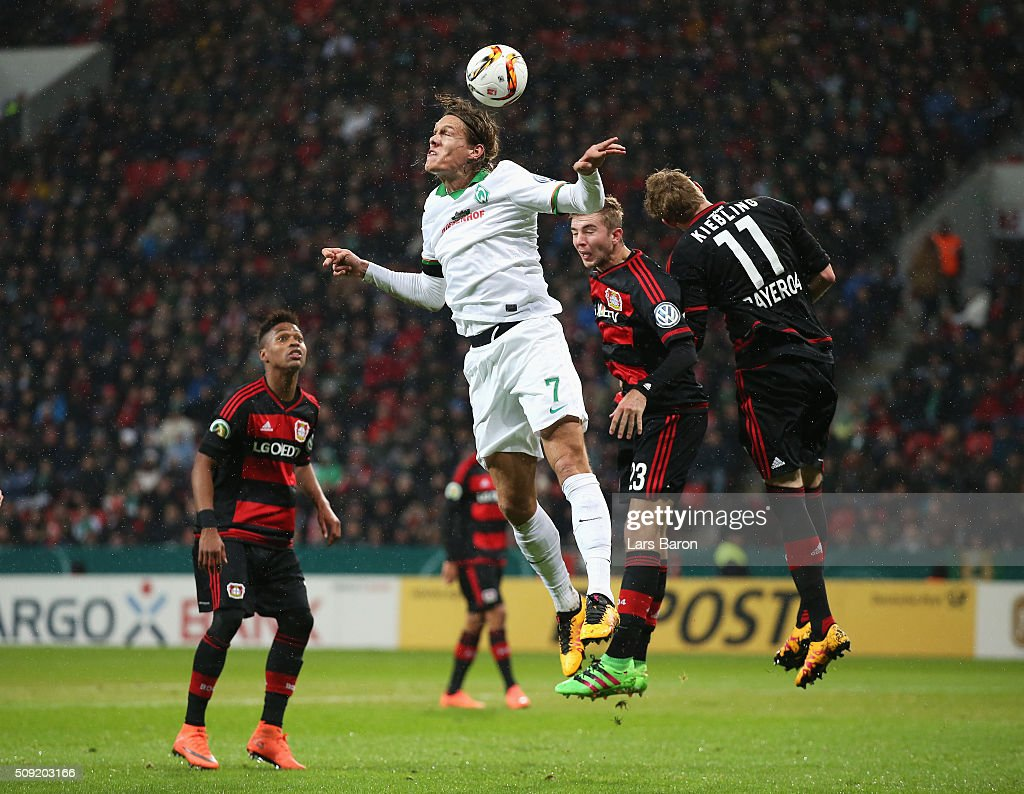 <a gi-track='captionPersonalityLinkClicked' href=/galleries/search?phrase=Jannik+Vestergaard&family=editorial&specificpeople=7174952 ng-click='$event.stopPropagation()'>Jannik Vestergaard</a> of Werder Bremen jumps with <a gi-track='captionPersonalityLinkClicked' href=/galleries/search?phrase=Christoph+Kramer&family=editorial&specificpeople=5588926 ng-click='$event.stopPropagation()'>Christoph Kramer</a> (23) and Stephan Kiessling of Bayer Leverkusen (11) during the DFB Cup Quarter Final match between Bayer Leverkusen and Werder Bremen at BayArena on February 9, 2016 in Leverkusen, Germany.