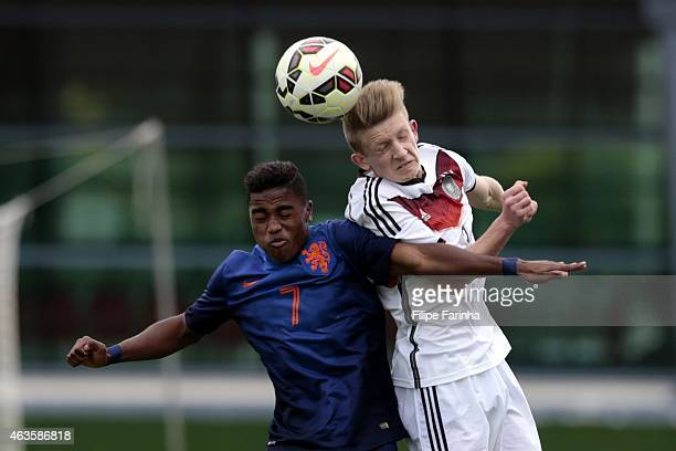 JanNiklas Beste of Germany challenges Che Nunnely of Netherlands during the U16 UEFA development tournament between Germany and Netherlands on...