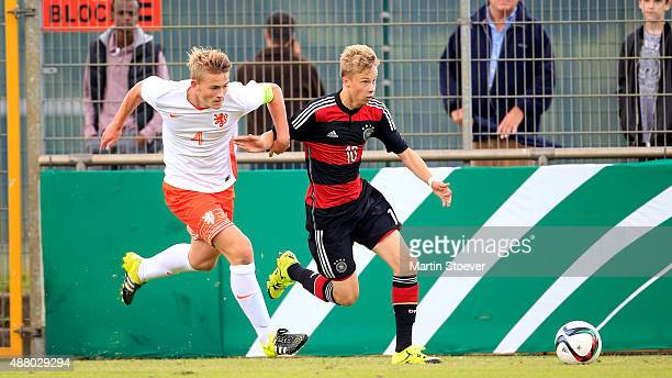 JanNiklas Beste of U17 Germany challenges Matthijs de Ligt of U17 Netherlands during the match between U17 Germany v U17 Netherlands at Sportpark...