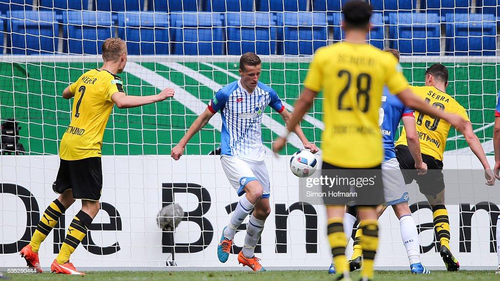 Janni-Luca Serra of Dortmund (R) scores his team's fourth goal during the A Juniors German Championship Final match between 1899 Hoffenheim U19 and Borussia Dortmund U19 at Wirsol Rhein-Neckar-Arena on May 29, 2016 in Sinsheim, Germany.