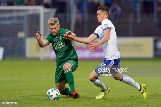 Jannis Flaskamp of Guetersloh and Fabian Reese of Schalke battle for the ball during the preseason friendly match between FC Gütersloh and FC Schalke...
