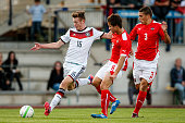 Jannis Mause of Germany competes for the ball with Daniel Hautzinger and Michael Augustin of Austria during the TOTO Cup match between U17 Austria...