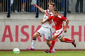 Jannis Mause of Germany competes for the ball with Michael Augustin of Austria during the TOTO Cup match between U17 Austria and U17 Germany on...