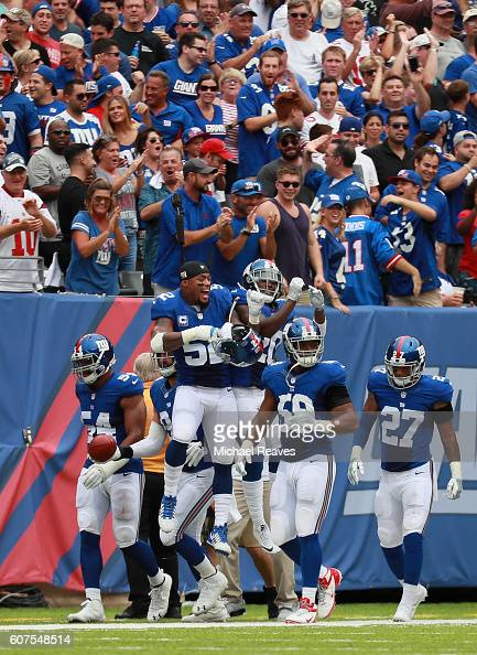Janoris Jenkins of the New York Giants celebrates his 65yard touchdown with teammate Jonathan Casillas during second quarter against the New Orleans...