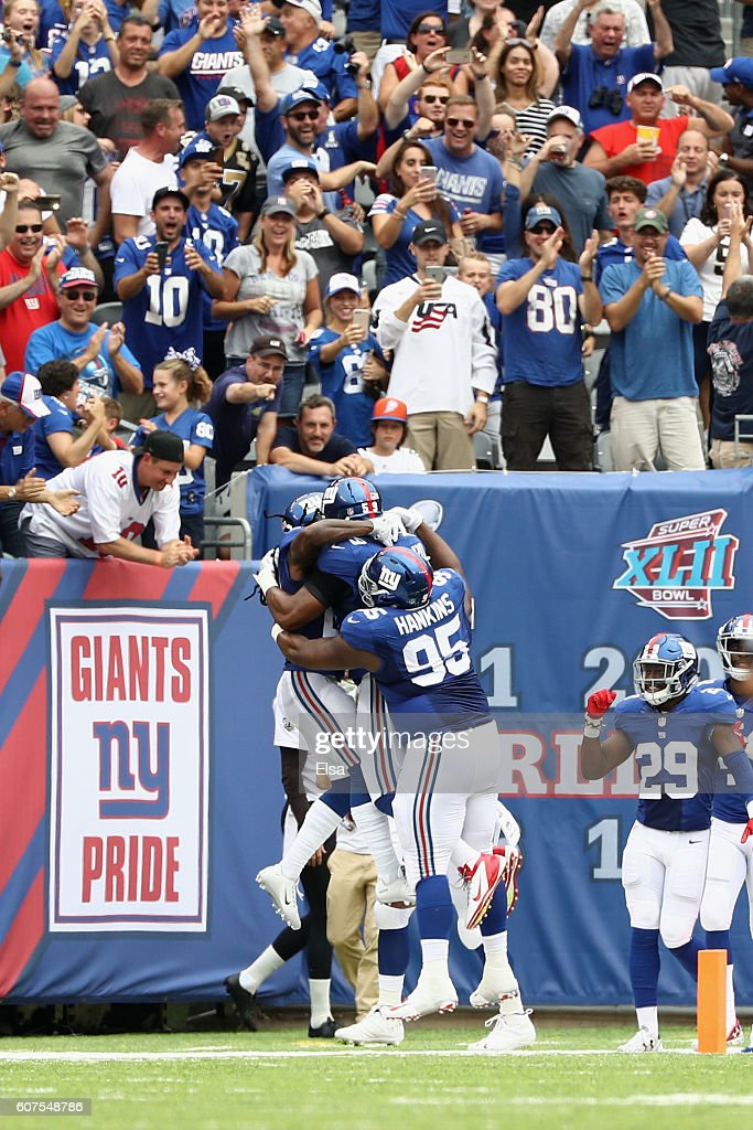 Janoris Jenkins #20 of the New York Giants celebrates his 65-yard touchdown with teammate Devon Kennard #59 and Johnathan Hankins #95 during second quarter against the New Orleans Saints at MetLife Stadium on September 18, 2016 in East Rutherford, New Jersey.