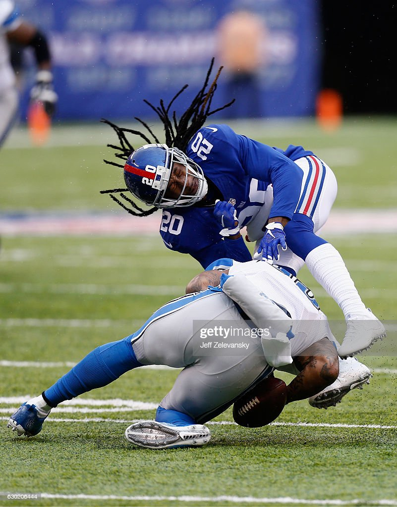 Janoris Jenkins #20 of the New York Giants collides with a Detroit Lions player in the first half at MetLife Stadium on December 18, 2016 in East Rutherford, New Jersey.
