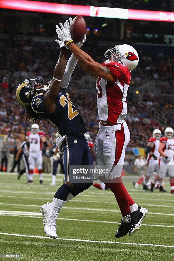 Janoris Jenkins #21 of the St. Louis Rams breaks up a pass intended for Michael Floyd #15 of the Arizona Cardinals at the Edward Jones Dome on September 8, 2013 in St. Louis, Missouri. The Rams beat the Cardinals 27-24.