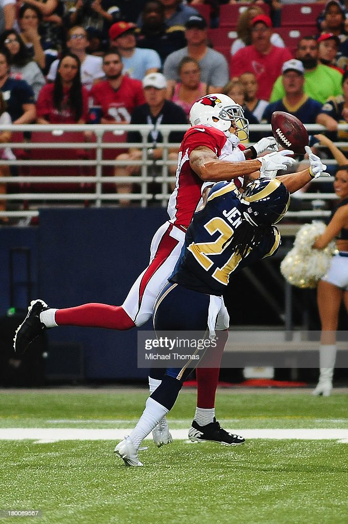 <a gi-track='captionPersonalityLinkClicked' href=/galleries/search?phrase=Janoris+Jenkins&family=editorial&specificpeople=5514119 ng-click='$event.stopPropagation()'>Janoris Jenkins</a> #21 of the St. Louis Rams breaks up a pass intended for Michael Floyd #15 of the Arizona Cardinals at the Edward Jones Dome on September 8, 2013 in St. Louis, Missouri.