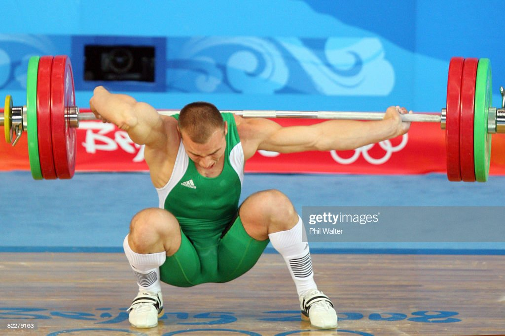 Janos Baranyai of Hungary screams in pain after dropping the weights during the Men's 77kg weightlifting competition event at the University of Aeronautics and Astronautics Gymnasium during Day 5 of the Beijing 2008 Olympic Games on August 13, 2008 in Beijing, China.