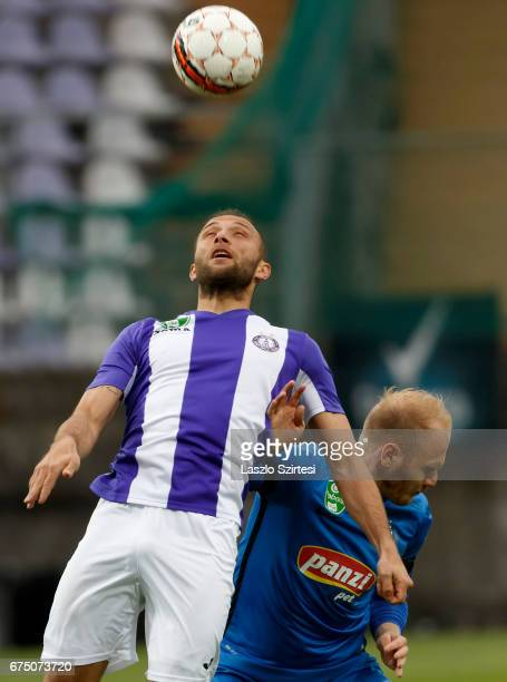 Janos Lazok of Ujpest FC wins the ball in the air from Patrik Poor of MTK Budapest during the Hungarian OTP Bank Liga match between Ujpest FC and MTK...