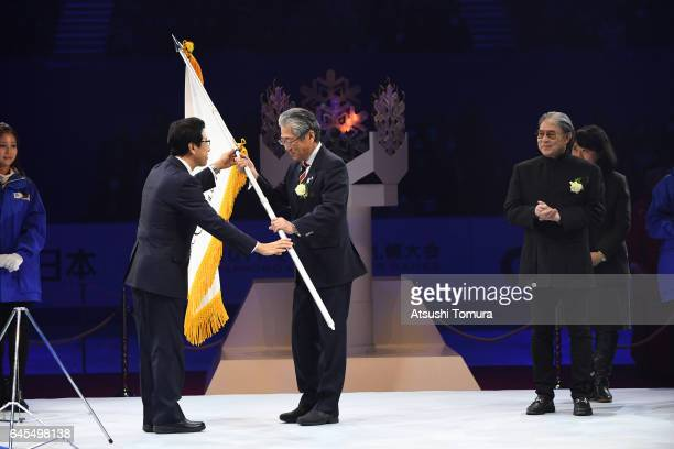 Janpan Olympic committee president Tsunekazu Takeda accepts the Asian games flag from President of the organising committee Katsuhiro Akimoto the...