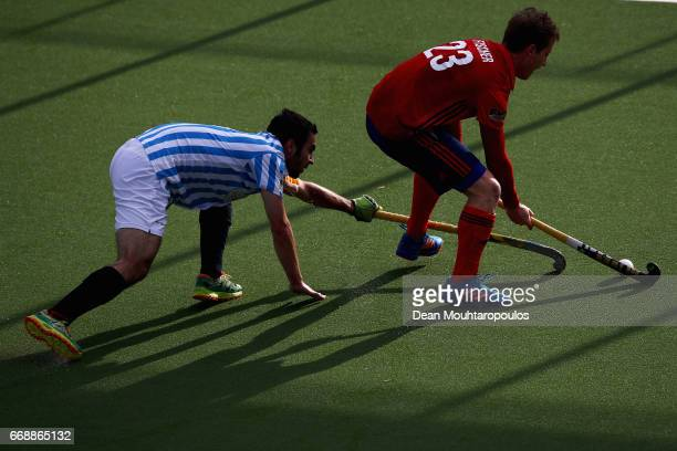 JanPhilipp Fischer of Mannheimer HC battles for the ball with Franc Dinares of Club Egara during the Euro Hockey League KO16 match between Mannheimer...