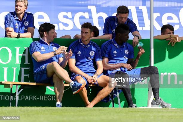 JanPieter Martens of Schalke Leon Goretzka of Schalke and Breel Embolo of Schalke sits on the bench during the preseason friendly match between FC...