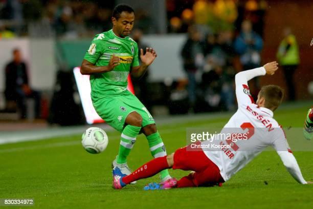 JanSteffen Meier of Essen challenges Raffael of Mnchengladbach during the DFB Cup first round match between RotWeiss Essen and Borussia...