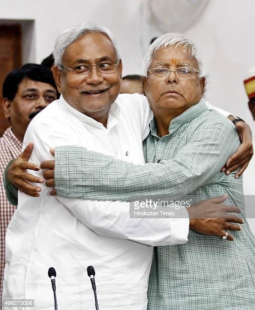 Janta Dal leader Nitish Kumar and Rashtriya Janta Dal leader Lalu Prasad Yadav celebrate during a press conference after landslide victory in Bihar...