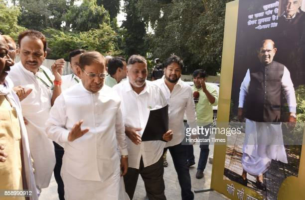 Janta Dal leader Sharad Yadav with Chhotubhai Amarsinh Vasava acting President of party his party leaders during JD National Council Meeting on...