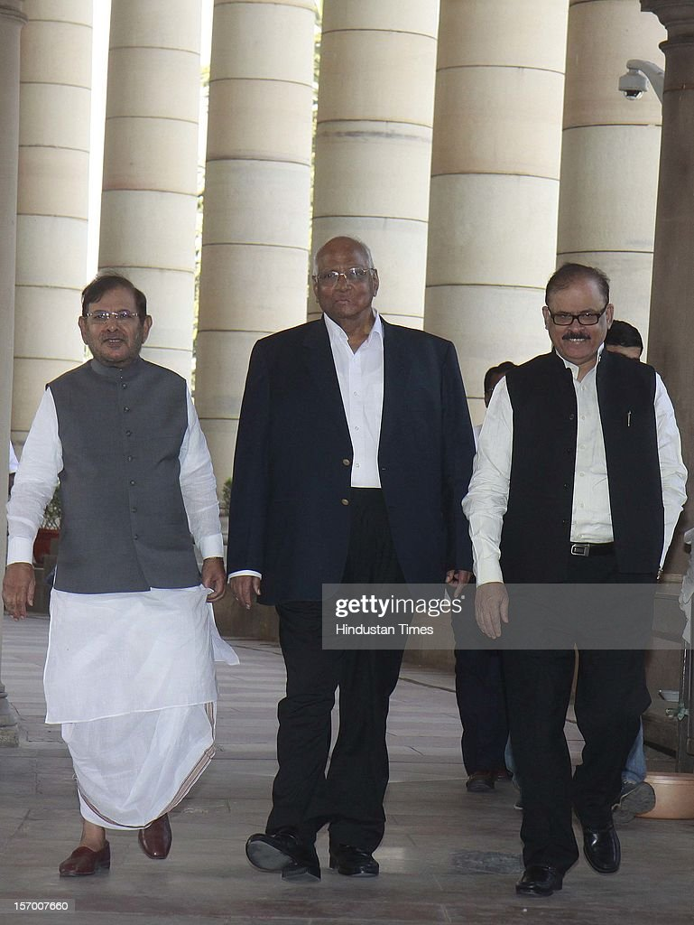 Janta Dal ( U) President Sharad Yadav, NCP President Sharad Pawar and NCP Leader Taraq Anwar arrive attending all party meeting on to break the deadlock on Foreign Direct Investment issue during the Parliament winter session on November 26, 2012 in New Delhi, India. Main opposition party BJP wants debate under rule 184 which has provision of vote but government wants the speaker to decide on debate rules.