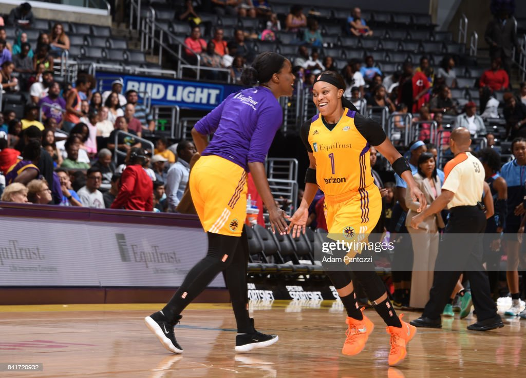 Jantel Lavender #42 and Odyssey Sims #1 of the Los Angeles Sparks react to a play during the game against the Atlanta Dream on September 1, 2017 at the STAPLES Center in Los Angeles, California.