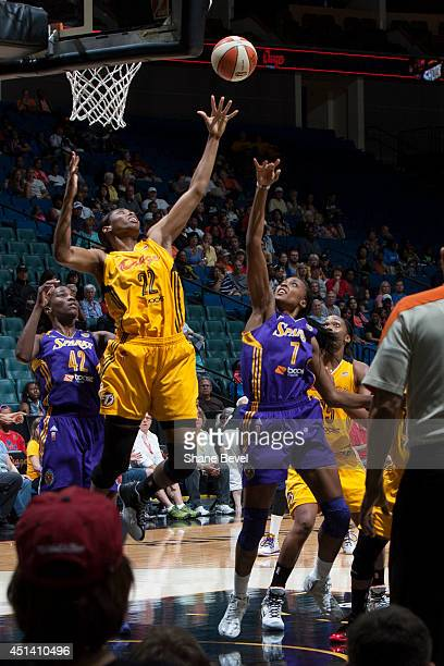 Jantel Lavender and Sandrine Gruda of the Los Angeles Sparks reach for a rebound against Vicki Baugh of the Tulsa Shock during the WNBA game on June...
