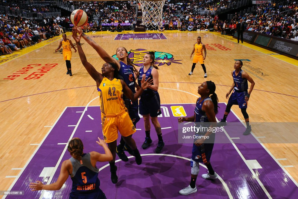 Jantel Lavender #42 of the Los Angeles Sparks and Brittney Griner #42 of the Phoenix Mercury jump for the rebound on June 18, 2017 at STAPLES Center in Los Angeles, California.