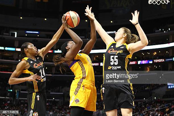 Jantel Lavender of the Los Angeles Sparks goes to the basket against Vicki Baugh and Theresa Plaisance of the Tulsa Shock in a WNBA game at Staples...
