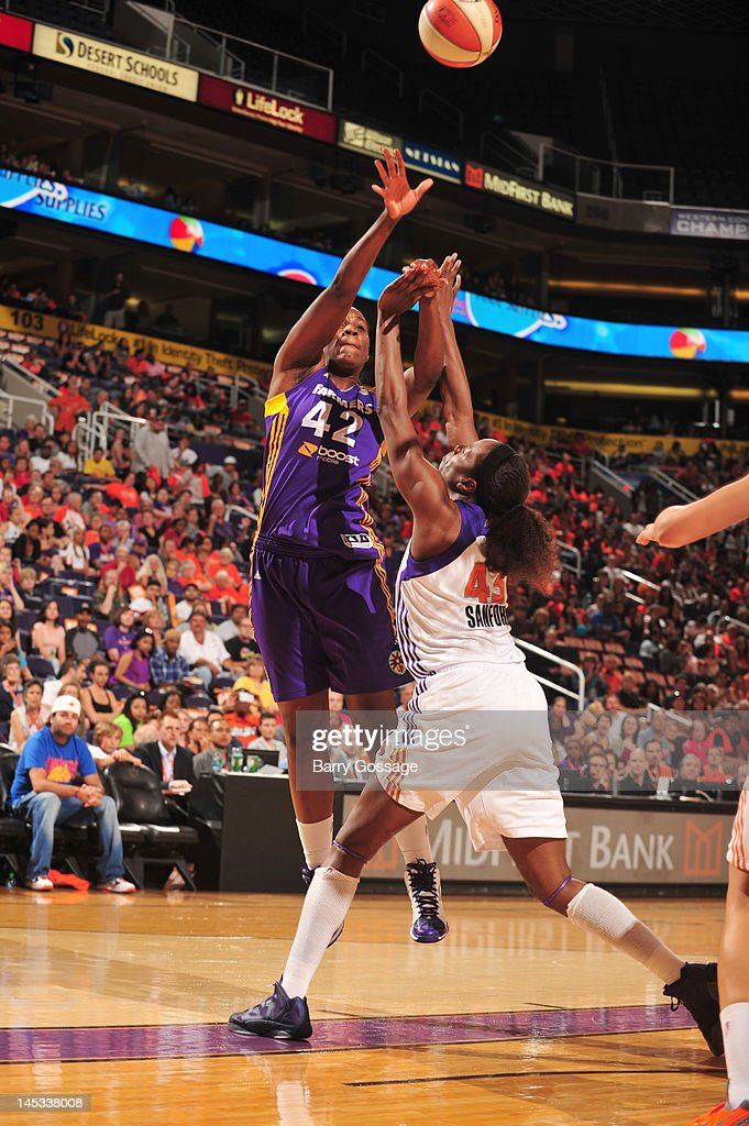 Jantel Lavender of the Los Angeles Sparks reaches for the ball against Nakia Sanford of the Phoenix Mercury during the game between the Phoenix...