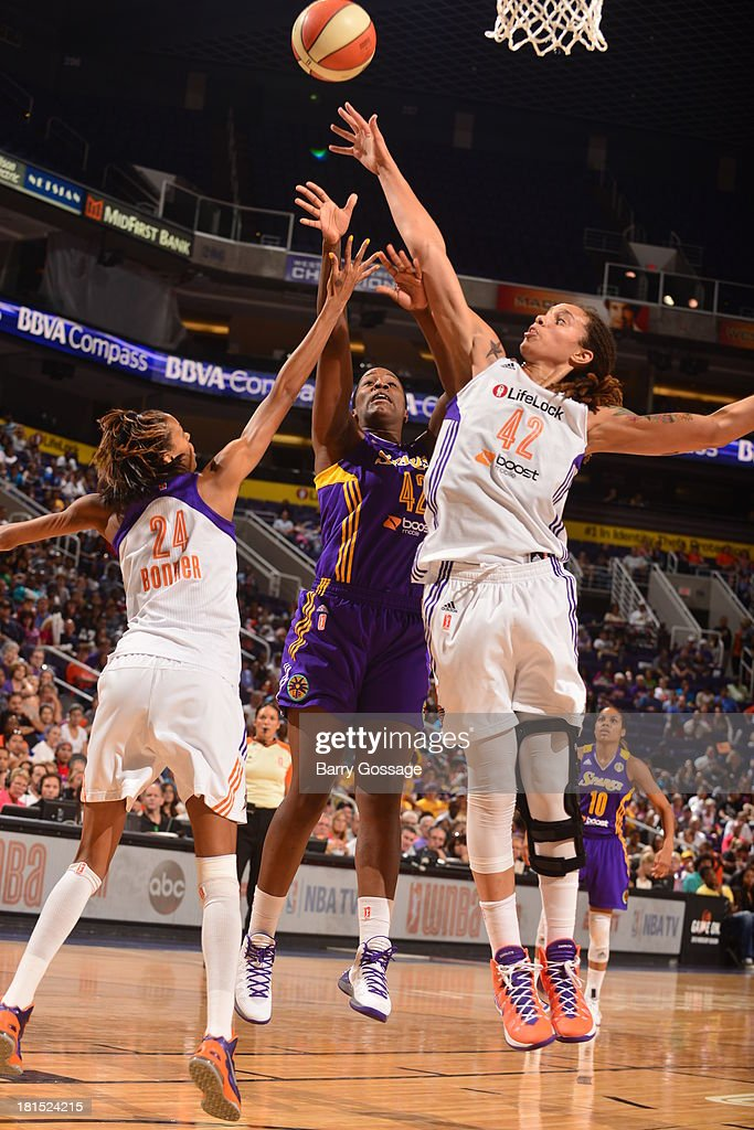 <a gi-track='captionPersonalityLinkClicked' href=/galleries/search?phrase=Jantel+Lavender&family=editorial&specificpeople=4215911 ng-click='$event.stopPropagation()'>Jantel Lavender</a> #42 of the Los Angeles Sparks shoots against <a gi-track='captionPersonalityLinkClicked' href=/galleries/search?phrase=Brittney+Griner&family=editorial&specificpeople=6836945 ng-click='$event.stopPropagation()'>Brittney Griner</a> #42 of the Phoenix Mercury in Game 2 Round 1 of the 2013 WNBA Playoffs on September 13, 2013 at U.S. Airways Center in Phoenix, Arizona.