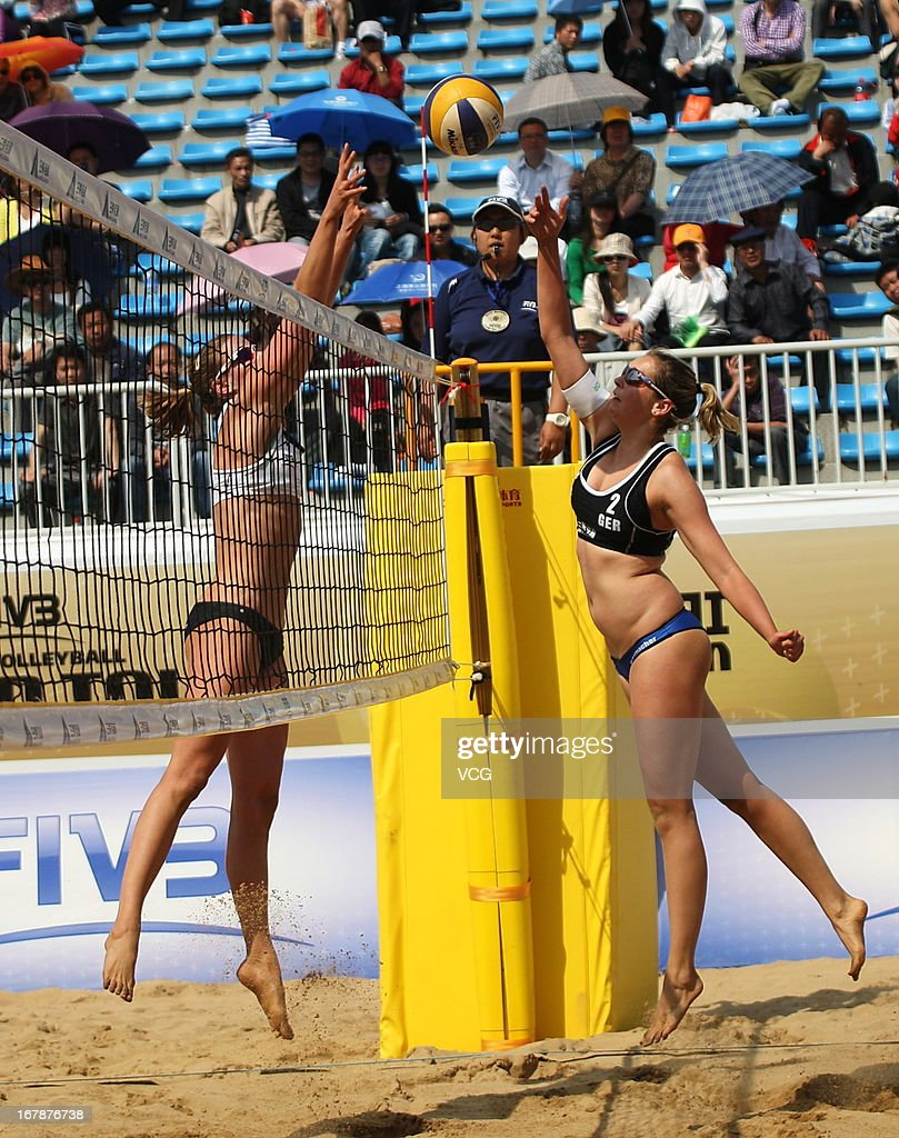 Jantine van der Vlist (L) of The Netherlands defends against Anni Schumacher (R) of Germany during the women's qualification of FIVB Beach Volleyball Shanghai Grand Slam at Jinshan City Beach on May 1, 2013 in Shanghai, China.