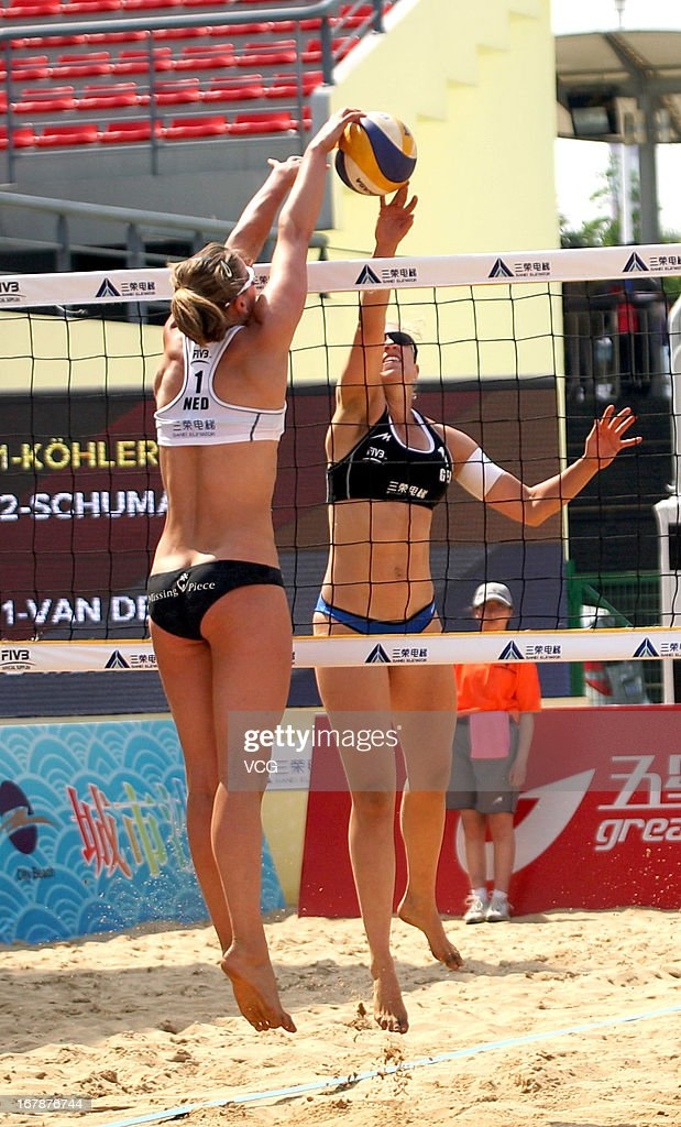 Jantine van der Vlist (L) of The Netherlands defends against Jana Kohler (R) of Germany during the women's qualification of FIVB Beach Volleyball Shanghai Grand Slam at Jinshan City Beach on May 1, 2013 in Shanghai, China.