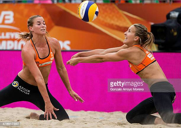 Jantine Van Der Vlist of The Netherlands sets the ball close to her teammate Sophie Van Gestel during the FIVB Beach Volleyball World Championships...