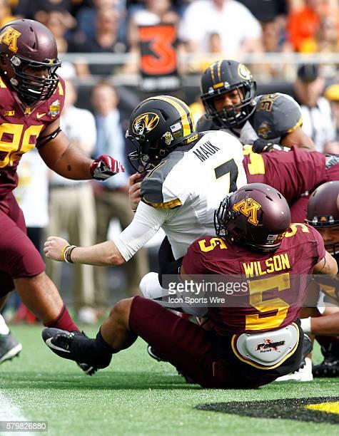 Minnesota Golden Gophers linebacker Damien Wilson sacks Missouri Tigers quarterback Maty Mauk in the first half of play at the Florida Citrus Bowl...