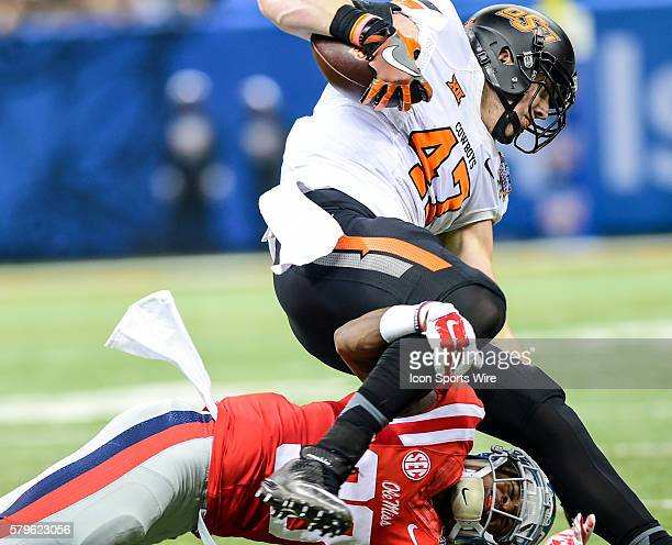 Ole Miss Rebels defensive back Mike Hilton upends OK State Cowboys tight end Blake Jarwin during the 2016 Allstate Sugar Bowl featuring the Oklahoma...
