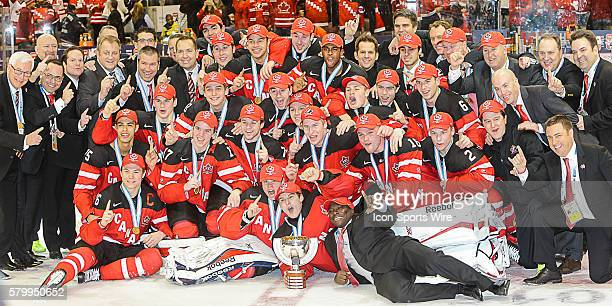 Team Canada players and coaching staff celebrate with championship trophy following Canada's 54 victory over Russia at the IIHF World Junior...