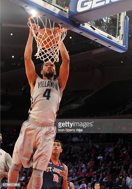 Villinova guard Darrun Hilliard looks down as he slams home a big dunk in the second half of the game against StJohns Villinova went on to win the...