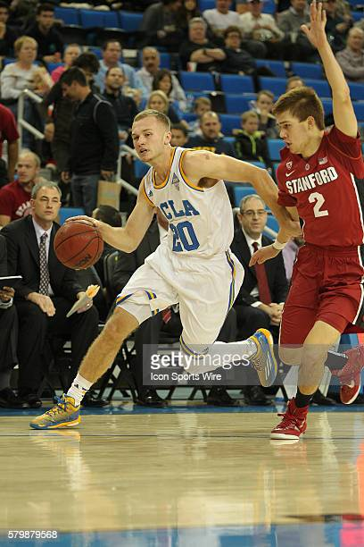 Bryce Alford of the UCLA Bruins dribbles past Robert Cartwright of the Stanford Cardinal during the game at the Pauley Pavilion in Los Angeles CA