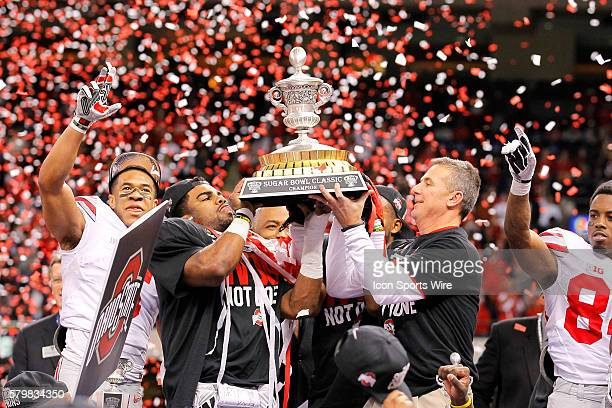 Ohio State Buckeyes running back Ezekiel Elliott and Ohio State Buckeyes head coach Urban Meyer hold up the Sugar Bowl Classic trophy during the Ohio...