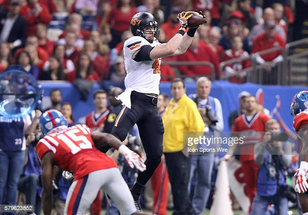 Oklahoma State Cowboys tight end Blake Jarwin leaps up for the catch during the Allstate Sugar Bowl between the Ole Miss Rebels and the Oklahoma...