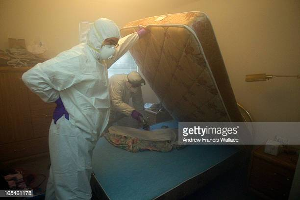 January 10 2011 Christian Cadieux owner of Bed Bugs Bite and employee Jeff Lake fumigates a matress as part of their process to get rid of bedbugs...