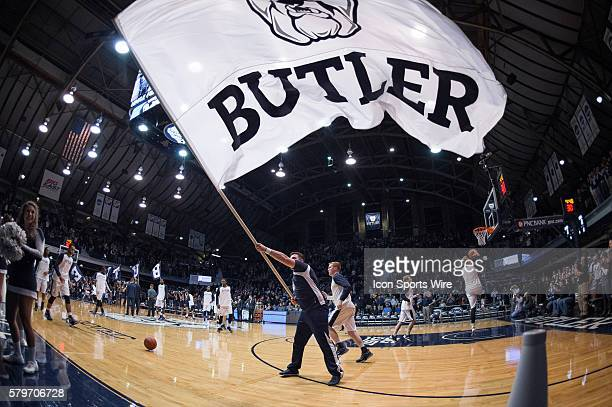 Butler cheerleader waves a flag before the NCAA basketball game between the Butler Bulldogs and Villanova Wildcats at Hinkle Fieldhouse in...