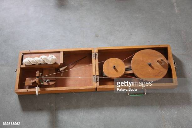 AHEMDABAD GUJARAT – January 10 A portable spinning wheel a worker called it akin to the modern lap top as it could be folded and taken anywhere to...