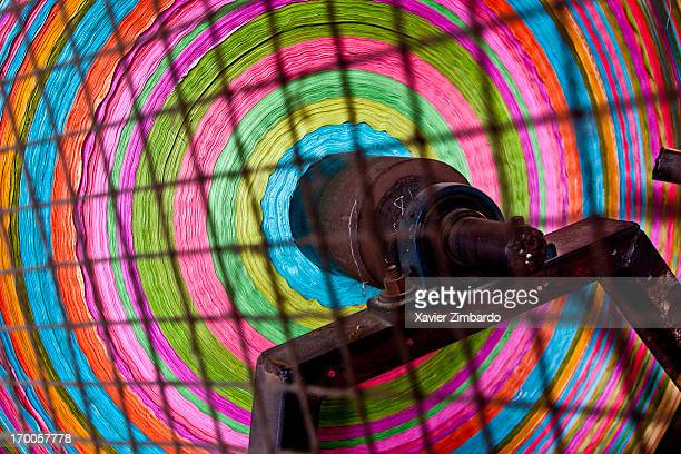 A roll of fabric dyed in different colours is ready for printing on January 10 2012 in a dyeing factory in Rajasthan India The multicoloured roll is...