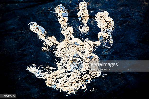 A worker's hand print on a black piece of fabric on January 10 2012 in a dyeing factory in Rajasthan India A piece of black cloth an image of a demon...