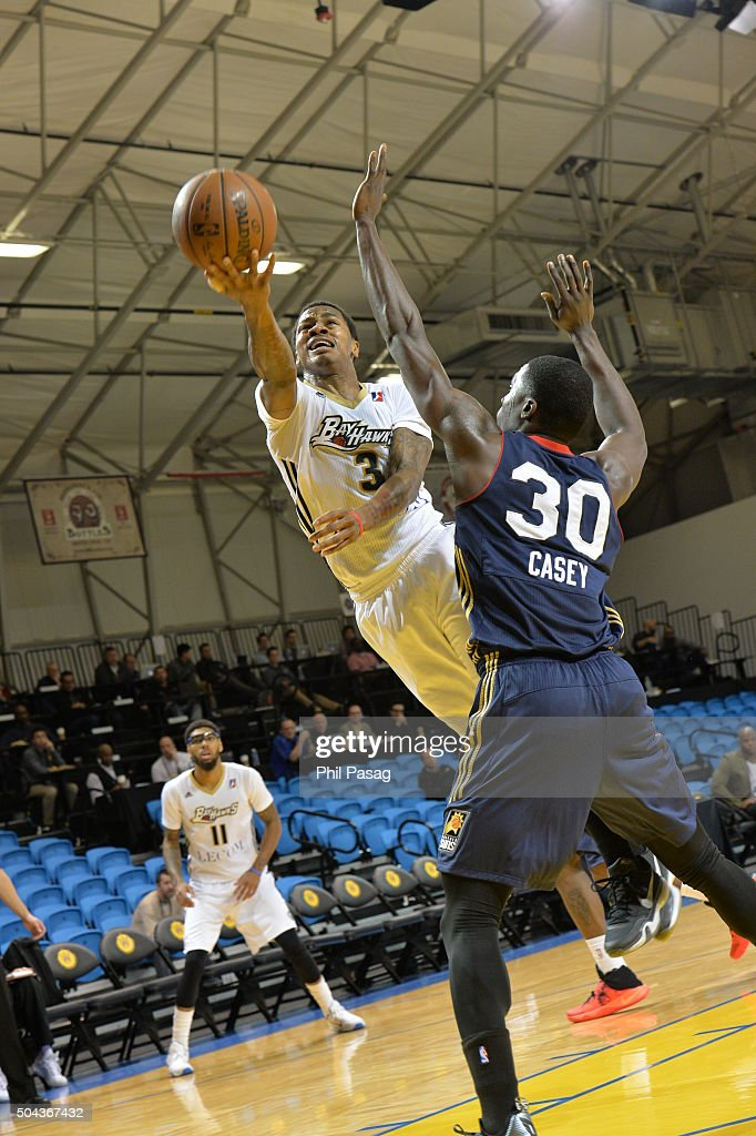 Keith Appling of the Erie BayHawks with the layup around Kyle Casey of the Bakersfield Jam at the Kaiser Permanente Arena in Santa Cruz California...