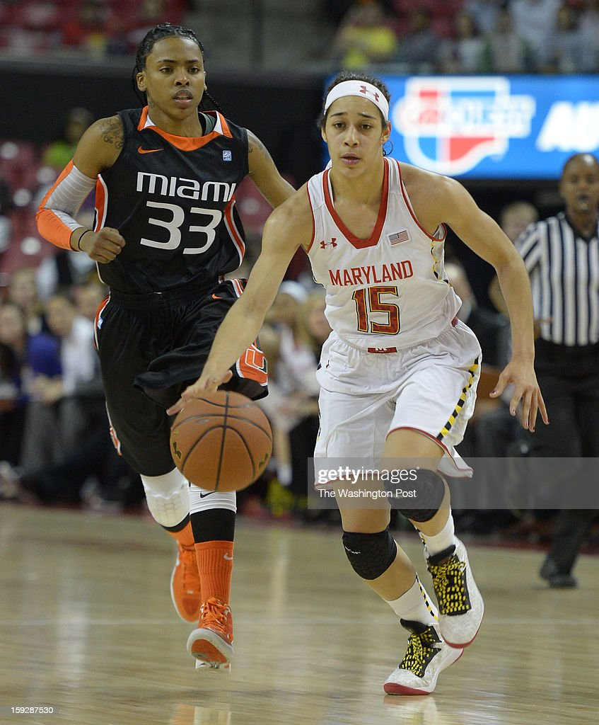 Maryland Terrapins guard Chloe Pavlech (15) starts the break against Miami (FL) Hurricanes guard Suriya McGuire (33) on January 10, 2013 in College Park, MD