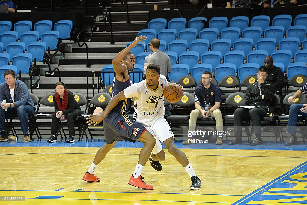 <a gi-track='captionPersonalityLinkClicked' href=/galleries/search?phrase=Melvin+Ejim&family=editorial&specificpeople=7493276 ng-click='$event.stopPropagation()'>Melvin Ejim</a> #7 of the Erie Bayhawks dribbles around <a gi-track='captionPersonalityLinkClicked' href=/galleries/search?phrase=Xavier+Munford&family=editorial&specificpeople=10183820 ng-click='$event.stopPropagation()'>Xavier Munford</a> #5 of Bakersfield Jam at Kaiser Permanente Arena in Santa Cruz, California.