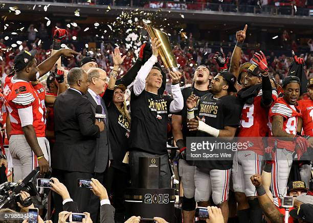 Ohio State Buckeyes head coach Urban Meyer lifts the trophy after the Ohio State Buckeyes game versus the Oregon Ducks in the College Football...