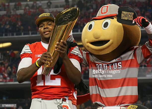 Ohio State Buckeyes quarterback Cardale Jones and mascot Brutus celebrate with the trophy after the Ohio State Buckeyes game versus the Oregon Ducks...
