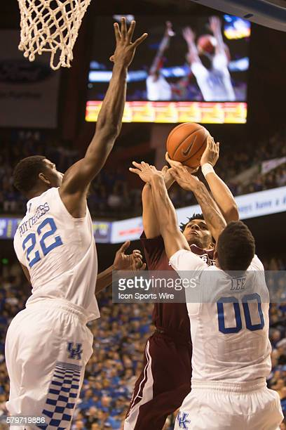 Mississippi State Bulldogs guard Quinndary Weatherspoon shoots as Kentucky Wildcats forward Alex Poythress and forward Marcus Lee attempt to block...