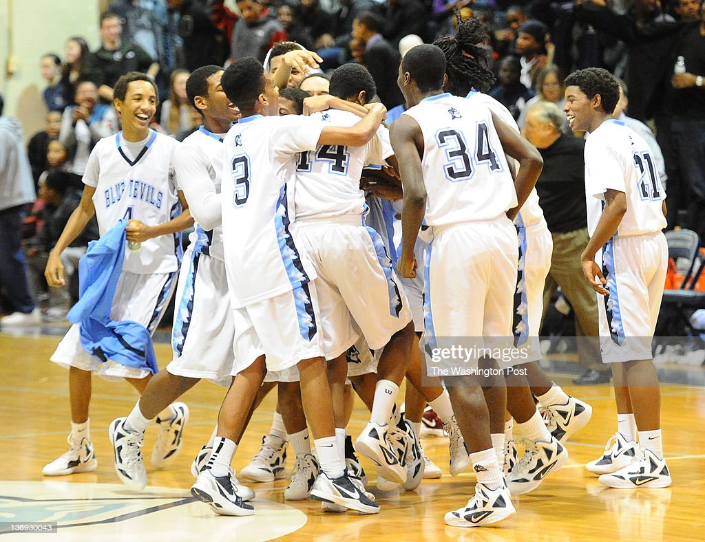 Springbrook F Andrew Robinson is greeted by his team after he dunked on Paint Branch to end regulation on January 12, 2012 in Silver Spring, MD