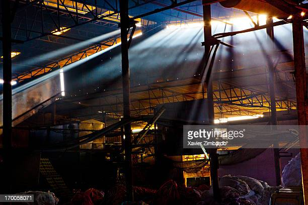 A fabric dyeing unit has piles of fabric awaiting dyeing on January 13 2012 at a dyeing factory in Rajasthan India